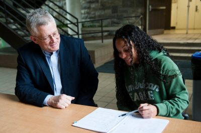 Photo of Pamplin College of Business Outstanding Faculty Mentor Cliff Ragsdale with a student